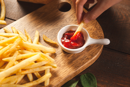 Fries with fried chicken and tomato sauce Stock Photo