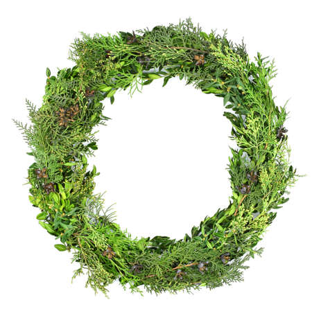 Natural wreath of evergreen branches with cones isolated on a white background. Christmas composition. Floral frame. Flat lounger, top view, space for copy.