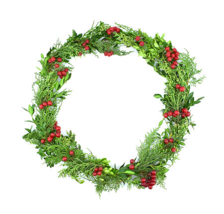 Christmas wreath of green sprigs of evergreens, decorated with red berries.