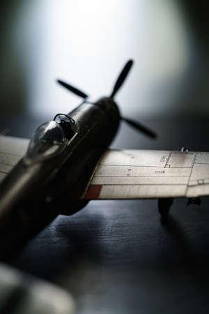 Plastic model  plane on dark background