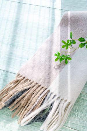 Woolen scarf on wooden background