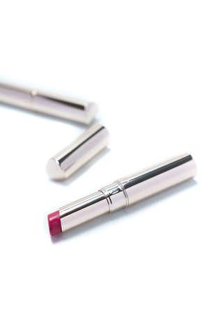 Colored lipstick on white background
