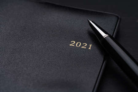 2021 Notebook and pen on wooden background (2021 schedule book)