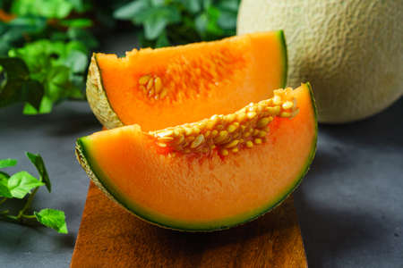 Whole and sliced of melons Standard-Bild