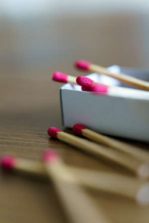 Matchbox and matches isolated on wooden table