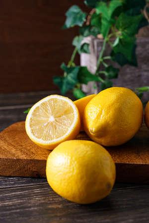 Fresh lemon fruit isolated on wooden table