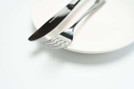 Empty plate, knife and fork