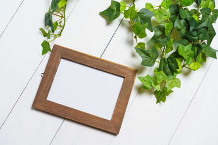 Picture frames on wooden table Imagens