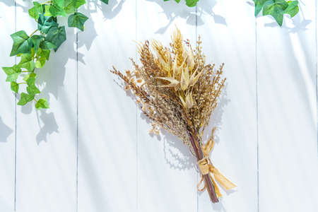 Dried flowers on wooden table