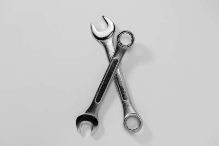 Set of spanners and wrenches on dark background