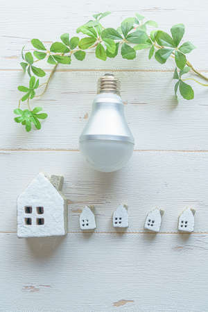 Led bulb and miniature house Stockfoto