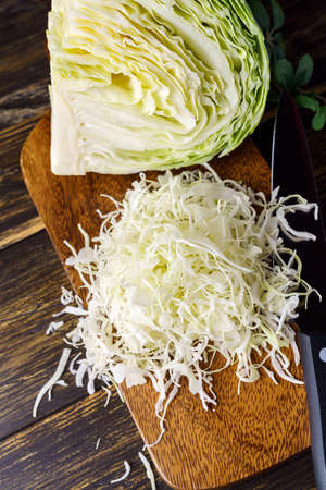 Fresh cabbage on wooden table
