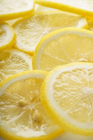 Sliced lemon fruit isolated on white background