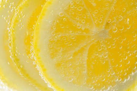 Sliced lemon in carbonated water