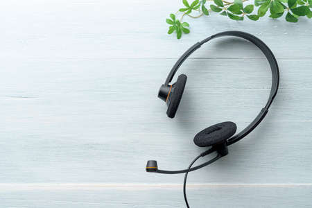 Headset isolated on wooden table