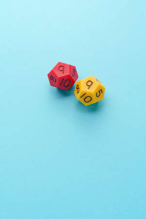 Multi sided dice on color background 免版税图像