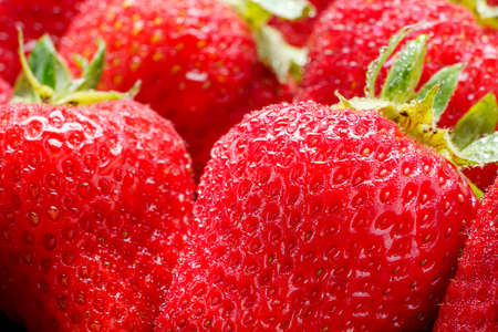 Fresh strawberry fruits isolated on wooden table Фото со стока