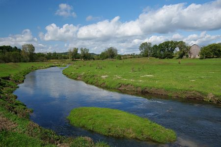 Prairie Stream: A rippling stream winds through grassy farmland in southern Wisconsin.