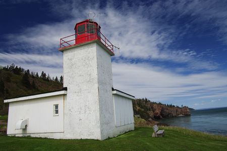 Personal Size Lighthouse: A small lighthouse keeps watch from the tip of Cape d'Or in Advocate Harbour, Nova Scotia, Canada. photo
