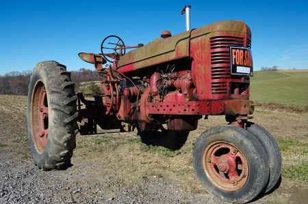 seeks: Old Tractor for Sale: An old tractor seeks a new owner Stock Photo