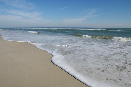 gentle: Sea Shore: Gentle waves reach the sand at Assateague Island National Seashore.