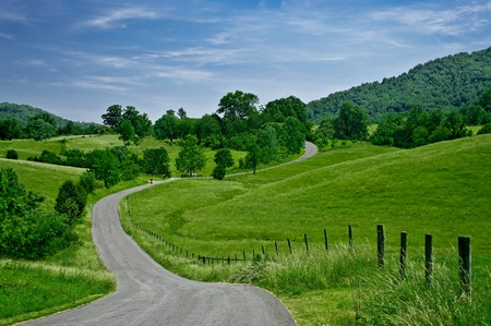 winding road: Byway:  A less-traveled road winds through the foothills of the Blue Ridge Mountains in western Virginia. Stock Photo