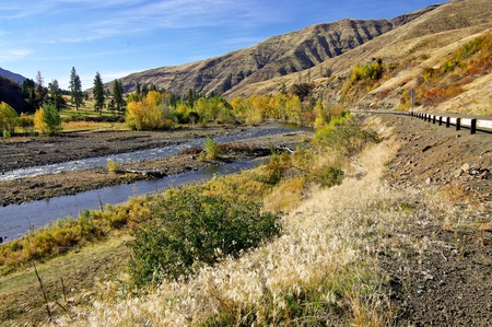 River Drive in Orego:  A scenic highway runs beside a river in the Hells Canyon region of eastern Oregon. Stock Photo