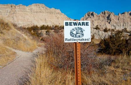 Beware of Rattlesnakes Sign   Hikers are warned of rattlesnakes in a portion of Badlands National Park Stock Photo - 12673034