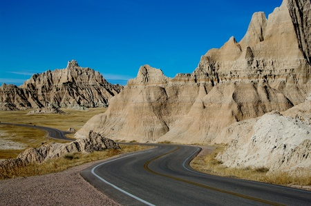 Park Road   A paved road winds through Badlands National Park  Stock Photo
