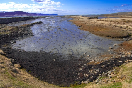 Fjord at Low Tide:  The shallow bottom at the end of an Icelandic fjord is visible between tides. photo