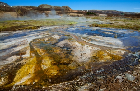 vents:  Hot Springs:  Mineral water emerges at near boiling temperatures and flows across colorful mud plains in an area of geothermal activity in southern Iceland.