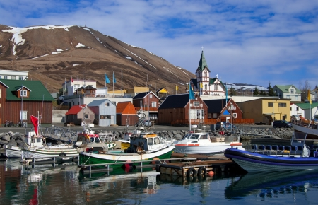 icelandic: Icelandic Seaport: Boats for fishing and for whale watching tours gather at the port of Husavik, Iceland. Stock Photo