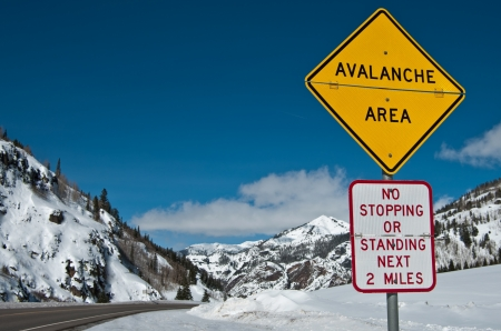 alpine zone: Avalanche Area Sign:  A convertible sign alerts winter travelers to possible snow slides in the Rocky Mountains of southwest Colorado.
