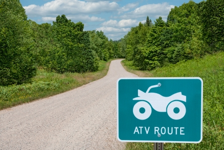 identifies: ATV Route   A road sign identifies a route for all-terrain vehicles in central Wisconsin