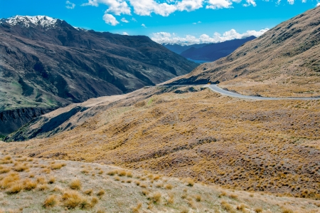 New Zealand Mountain Road   An inland road passes through arid mountain terrain north of Queenstown on New Zealand's South Island  photo