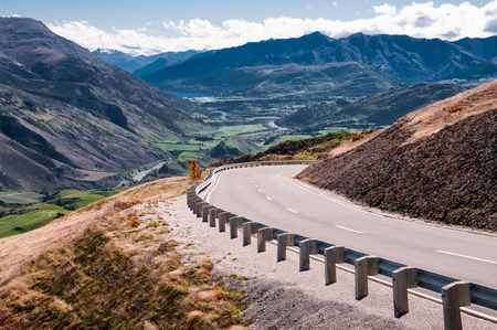 New Zealand Highway   A scenic road passes through mountains and valleys north of Queenstown on New Zealand South Island
