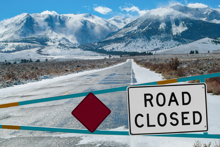 rocky road: Mountain Road Closed   A barrier gate stops traffic from crossing the Sierra Nevada Mountains during the winter months