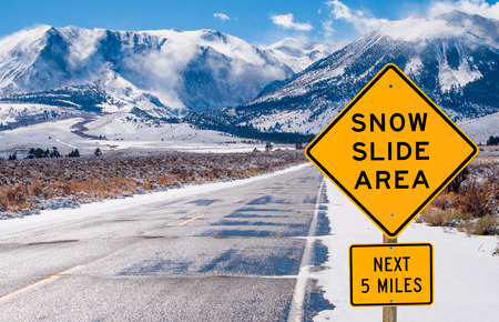 Snow Slide Area Sign   Motorists are warned of dangerous driving conditions on a road leading into the Sierra Nevada Mountains