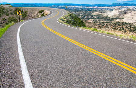 Scenic Road   A two lane road curves along a canyon rim in southern Utah Stock Photo - 30213304