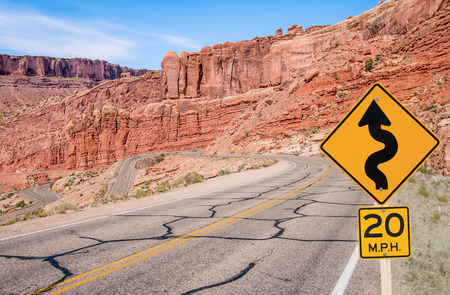 S-Curves Sign   A sign warns of sharp turns ahead on a road in southern Utah  Stock fotó