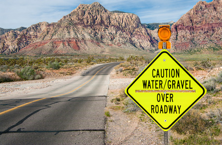 Flood Area Warning Sign:  A sign in southern Nevada warns of a flash flood area ahead. Stock Photo