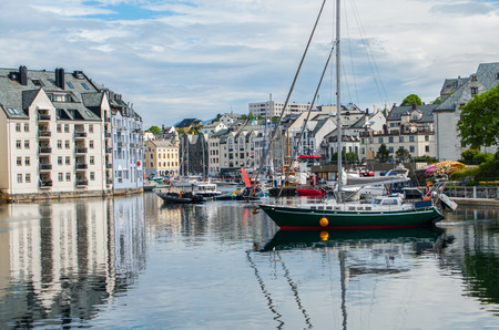 sailing: Norwegian Seaport:  Boats for sailing, fishing and touring gather in the port of Alesund, Norway. Stock Photo