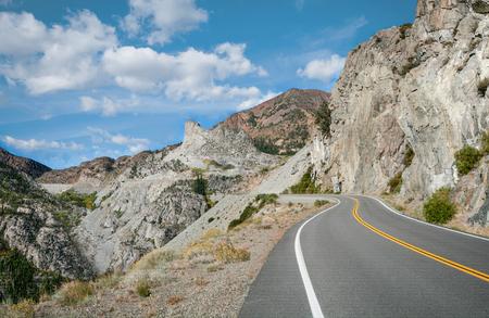 backroad: Sierra Mountain Pass:  A mountain road curves upward toward Tioga Pass near Yosemite National Park.