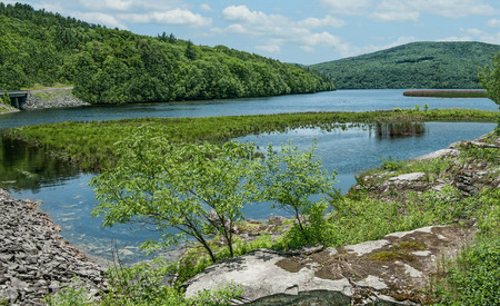 Upstate New York Reservoir: A man-made lake in the Catskill Mountains holds water for New York City residents.