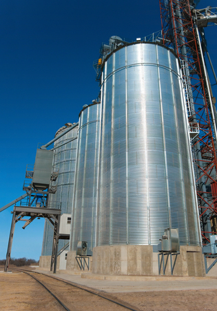 Railroad Grain Loading Station:  Large metal silos hold grain for shipping by rail at a station in southern Minnesota.