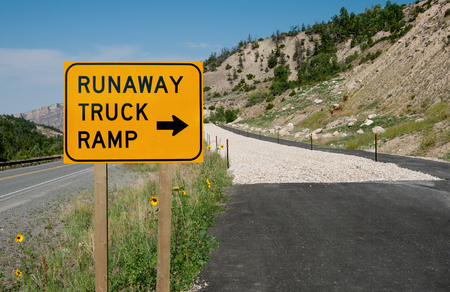 Runaway Truck Ramp Sign:  Truck drivers with failing brakes are offered an emergency escape route along a highway in the mountains of northeast Wyoming.