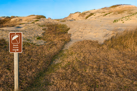 Beach Path and Sign:  A park sign directs hikers across the sand dunes at Cape Hatteras National Seashore.