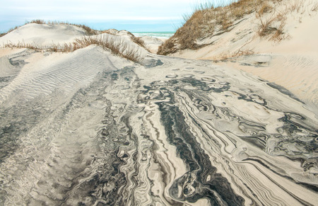North Carolina Sand Dunes:  Erosion by wind and rain reveals intricate patterns in the multi-layered surface of sand dunes at Cape Hatteras National Seashore.