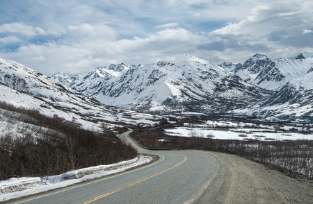 Alaska Mountain Byway:  A narrow road descends from Hatcher Pass in the mountains east of Anchorage. Stock Photo