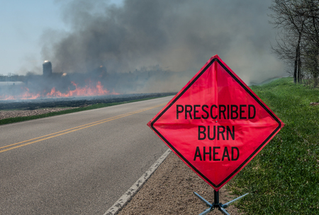 Prescribed Agricultural Burn Area and Sign:  A sign warns motorists of a controlled burn area ahead on a farm in southern Wisconsin.